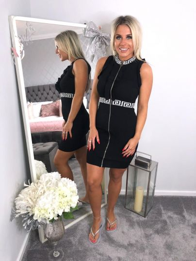 Black Dress with white collar and waist pattern