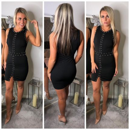 Black above knee dress with white dots